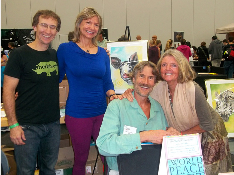 John Pierre, Lani Muelrath, Will Tuttle and wife Madeleine sharing a book table between our presentations at Portland Vegfest