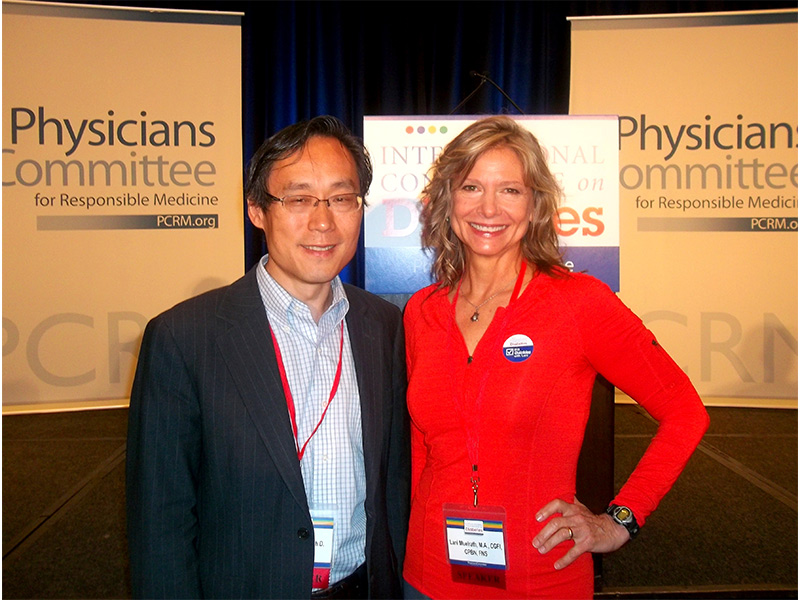 Dr. Frank Hu - of US Dietary Guideline fame and influence - with Lani at the PCRM Conference in D.C.